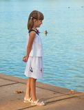 Child on the shore Royalty Free Stock Photo