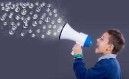 Child shouting through megaphone. Communication concept. Royalty Free Stock Photo