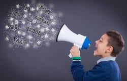 Child shouting through megaphone Royalty Free Stock Image