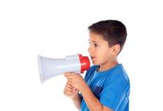 Child shouting through a megaphone. Isolated on white background Stock Photo