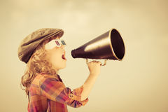 Child shouting through vintage megaphone Stock Images