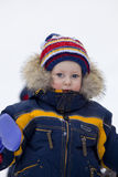 Child with shovel look at you in winter Stock Photography