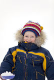 Child with shovel look at you in winter background Stock Photography