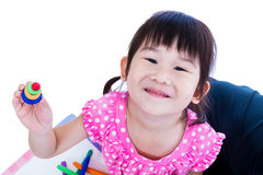 Child show her works from clay, over white. royalty free stock photo