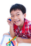 Child show his works from clay, over white. Strengthen the imagi Stock Photography