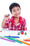 Child show his works from clay, over white. Strengthen the imagi Royalty Free Stock Photo