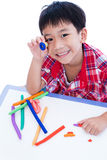 Child show his works from clay, over white. Strengthen the imagi Stock Photo