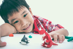 Child show his works from clay, on white. Strengthen the imagina Royalty Free Stock Photography