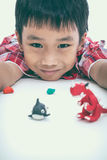 Child show his works from clay, on white. Strengthen the imagina Stock Photography