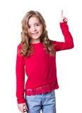 Child show point finger studio isolated on white. Caucasian child girl show point with finger studio isolated on white.Advertisement concept kid in fashion red Royalty Free Stock Image