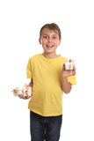 Child showcasing gifts. Child holding several gifts in one hand and displaying an individual one in the other royalty free stock photography