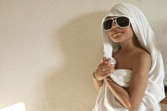 Child; shower; boy; towels; wet; sunglasses; house; vacation; cl Royalty Free Stock Images