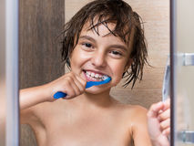 Child in shower Stock Images