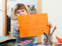 Child showing drawed paper Stock Photography