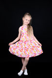 Child showing dress isolated on black background Stock Photos