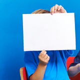 Child showing empty white piece of paper Stock Photography