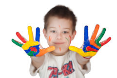 Child showing his colored hands Royalty Free Stock Image