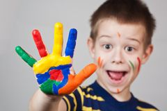 Child showing his colored hands Royalty Free Stock Photography