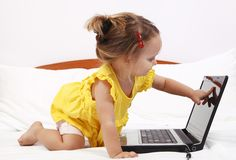 Child showing a laptop screen Royalty Free Stock Image