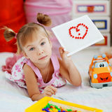 Child showing mosaic heart royalty free stock photos