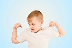 Child showing the muscle Royalty Free Stock Photo