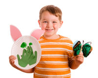 Child showing off his art projects Royalty Free Stock Images