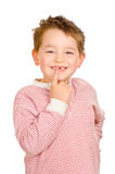 Child showing off his lost teeth. Isolated on white stock images