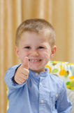 Child showing ok sign Royalty Free Stock Images