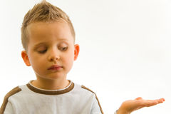 Child showing something on hand. Child showing something on his hand royalty free stock photos