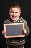 Child shows a blackboard stock images