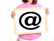 Child shows email symbol Stock Image