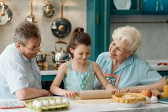 Child shows her cooking skills royalty free stock photography