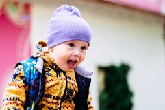 The child shows language and teases others royalty free stock photo