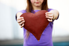 Child shows a red heart Royalty Free Stock Image