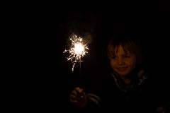Child shows satisfied his fireworks ready for the party Stock Images