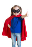 Child shows thumb up pretending to be a superhero stock photography