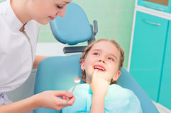 Child shows the tooth dentist. Regular visits to the doctor stock images