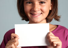 Child shows white card Stock Photo