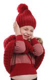 Child shutting her ears. Upset little girl covering her ears with her hands stock images