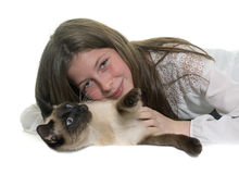 Child and siamese cat Stock Images