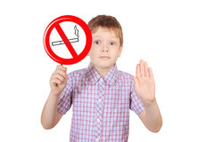 Child with a sign prohibiting smoking, the concept of Royalty Free Stock Photo