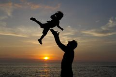 Child silhouette at the beach with sunset background royalty free stock image