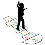 Child silhouette jumping over hopscotch Stock Photography