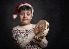 Child singing Christmas carol. At Christmas Stock Images