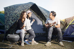 Child singing with family on camping. Child singing with smiling family on camping Royalty Free Stock Photos