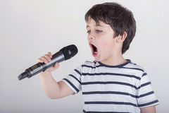 Child singing. With a microphone Royalty Free Stock Photo
