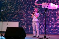 Child singing in microphone. LUTSK, UKRAINE - 02 June 2017: Child singing in microphone in cafe Stock Photo