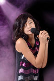 Child singing on stage Stock Photography