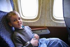 Сhild sit in plane Stock Photo