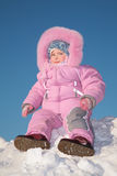 Child sit on snow hill Royalty Free Stock Photo